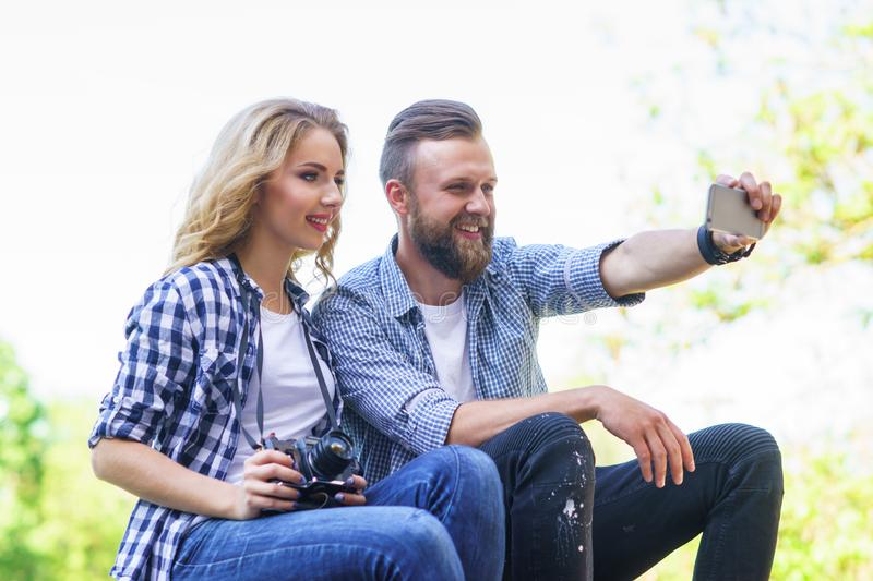 Young loving couple making selfie photo outdoor. royalty free stock photos