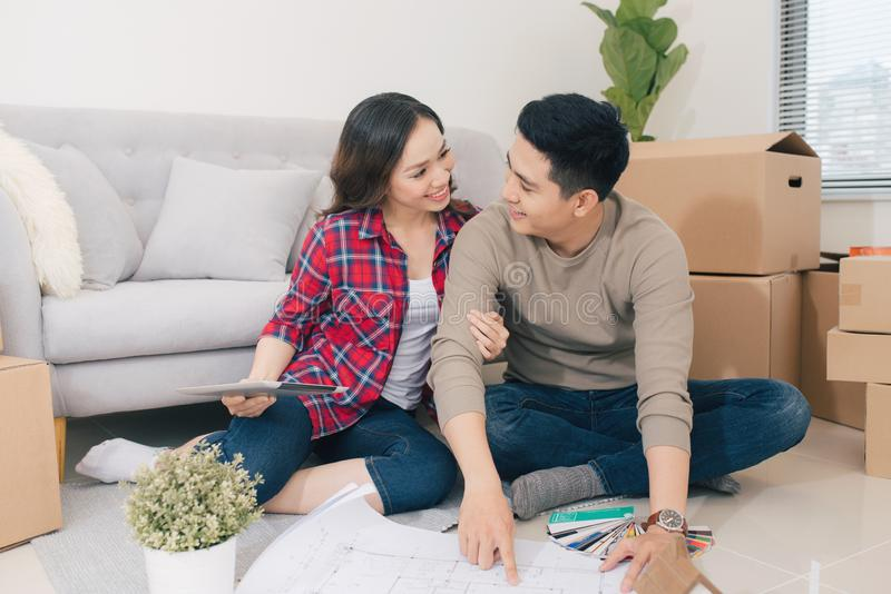 Young loving couple moving to a new house. Home and family concept royalty free stock photos