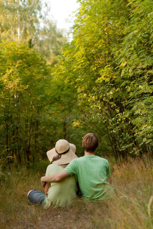 Young loving couple in nature stock images