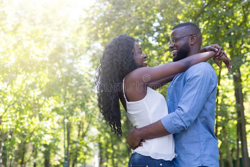 Young loving couple outdoors smiling and hugging royalty free stock images