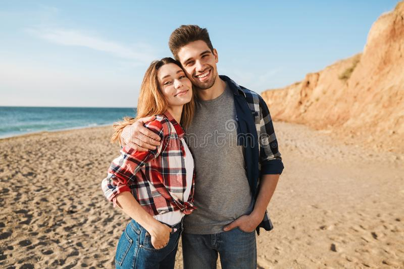 Young loving couple outside in free alternative vacation camping. Photo of happy young loving couple outside in free alternative vacation camping royalty free stock photography