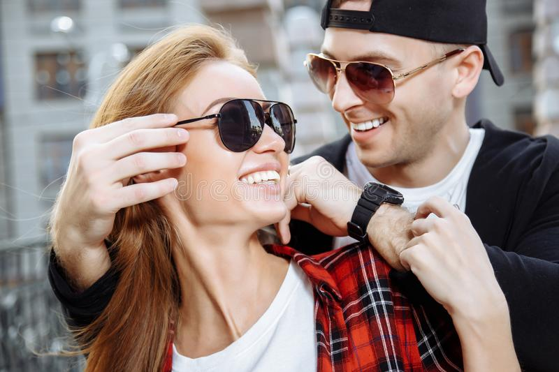Young loving couple in sunglasses having fun together. stock images
