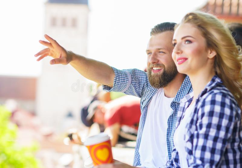 Young loving couple traveling to Tallinn. Love, relations and tourism concept. Young loving couple traveling to Tallinn. Man and women on a viewpoint. Love stock image