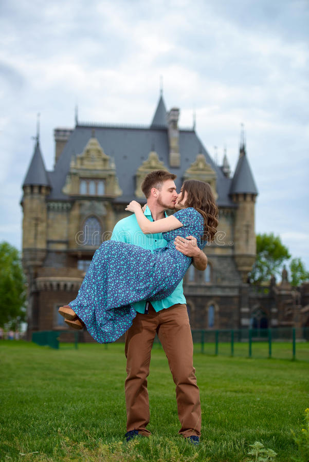 A young loving couple walking near of the castle. Wedding trip to honeymoon royalty free stock photos