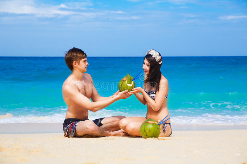Download Young Loving Happy Couple On Tropical Beach, With Coconuts Stock Photo - Image: 39782070