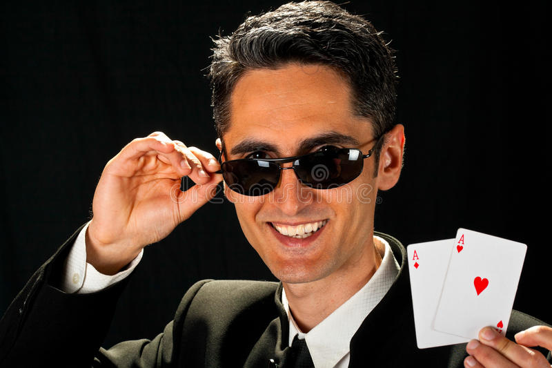 Young lucky gambler with cards royalty free stock photos
