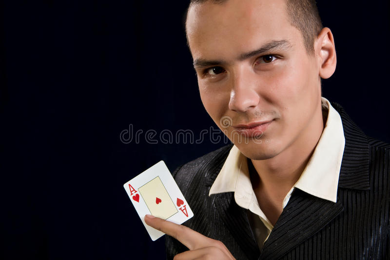 Young lucky gambler with cards stock photo