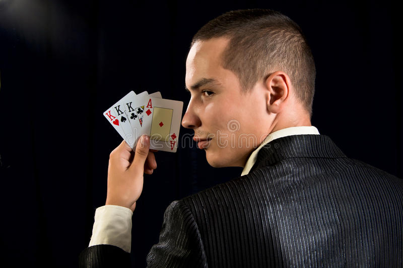 Young lucky gambler with cards stock photos