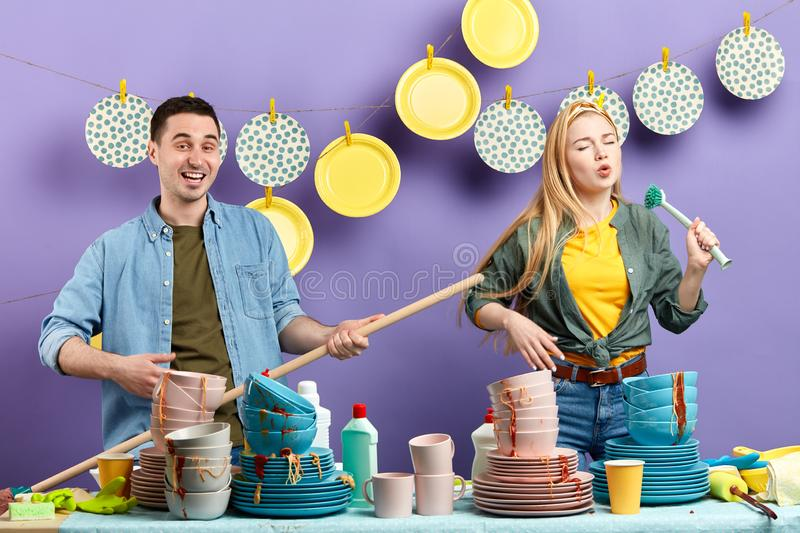 Young mad couple having fun in the kitchen with modern interior. studio shot royalty free stock image