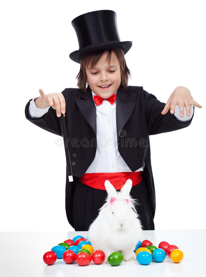 Young magician boy performing an easter trick stock image