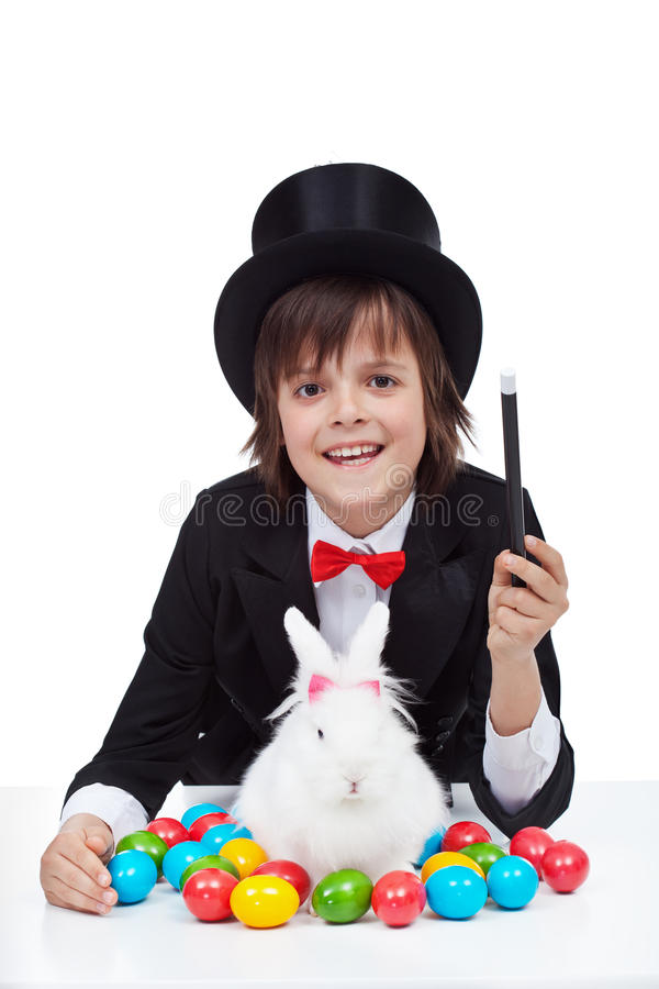 Young magician boy preparing for easter stock image