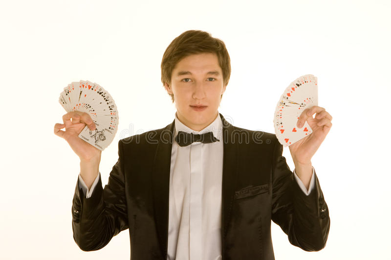 Young magician with cards royalty free stock image