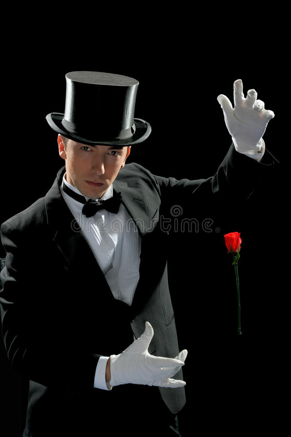 Young magician with rose stock photo