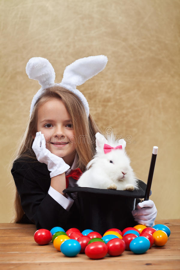 Young magician after successfully conjuring an easter rabbit stock photography