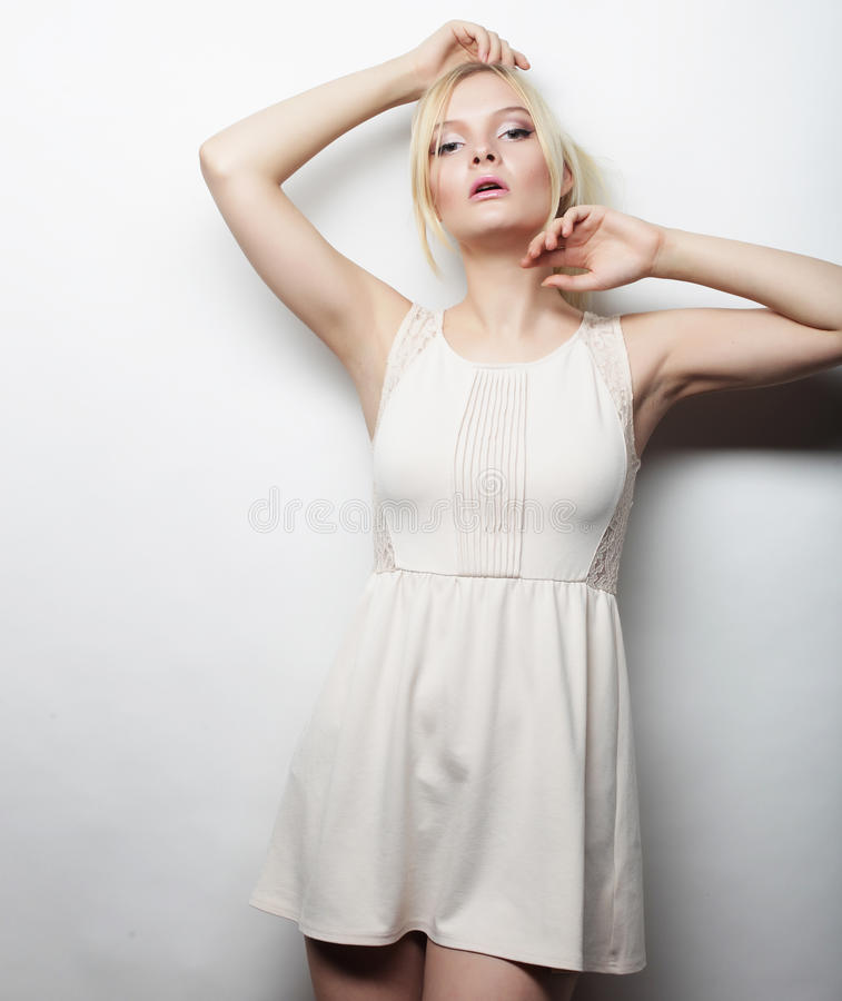 Young magnificent woman in white dress. stock photo