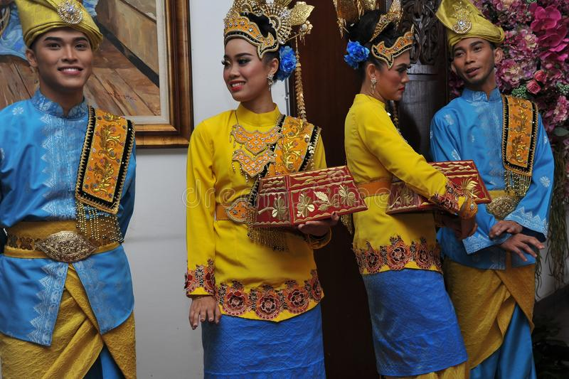 Young Malay Modal. With Traditional Costumes caring hand crafted beetle nut tepak sireh cointaner royalty free stock image