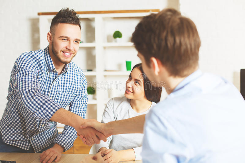 Young male accepted for a job. Handsome young male accepted for a job position after interview. Success concept royalty free stock photo