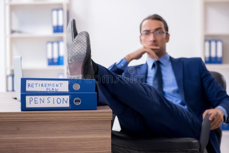 Young male accountant working in the office. The young male accountant working in the office royalty free stock photos