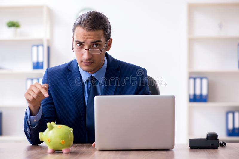 Young male accountant working in the office. The young male accountant working in the office stock photos