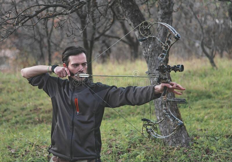 Archer shooting compound bow royalty free stock images