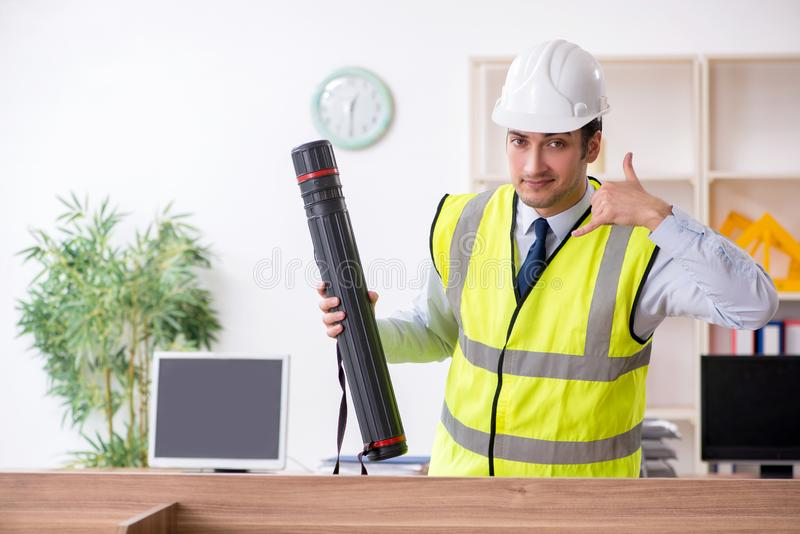 Young male architect working in the office. The young male architect working in the office stock photography