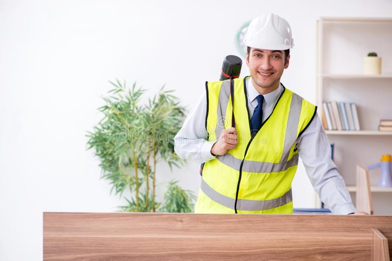Young male architect working in the office. The young male architect working in the office stock photos