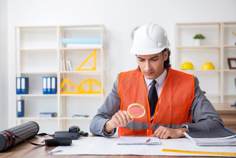 Young male architect working in the office stock images