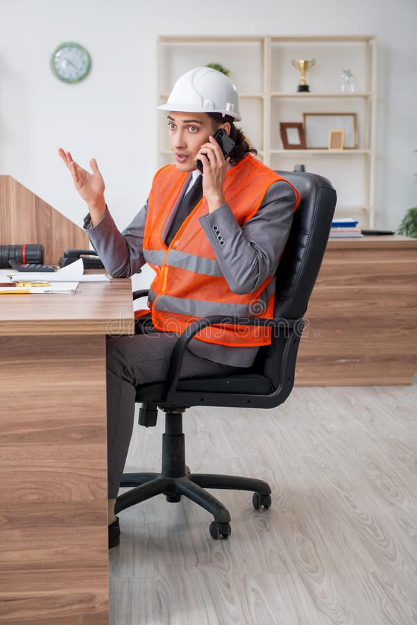 Young male architect working in the office royalty free stock photography