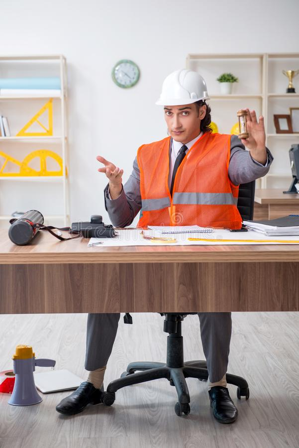 Young male architect working in the office stock photography