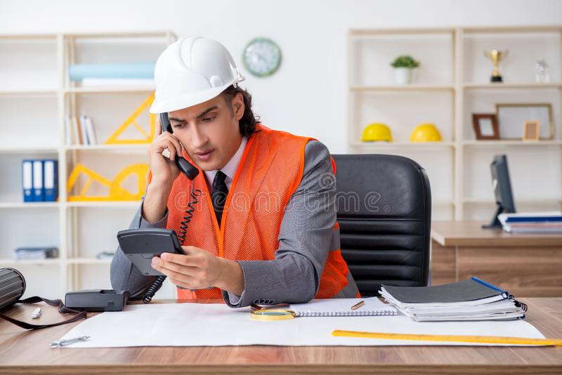 Young male architect working in the office royalty free stock images