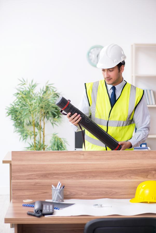 Young male architect working in the office. The young male architect working in the office royalty free stock photography
