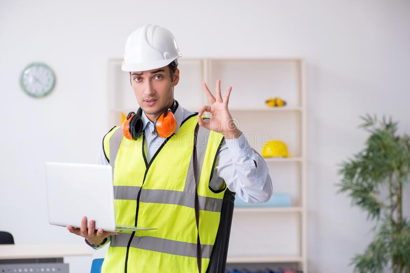 Young male architect working in the office. The young male architect working in the office royalty free stock images