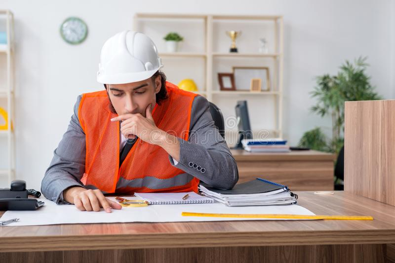 Young male architect working in the office stock image