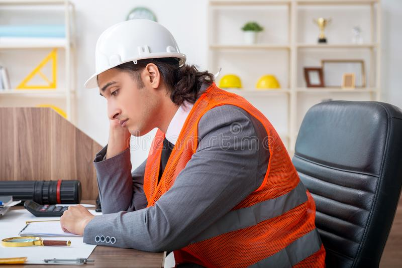 Young male architect working in the office stock photo