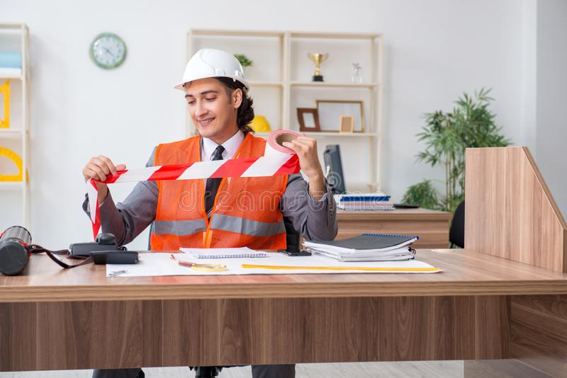 Young male architect working in the office stock photos