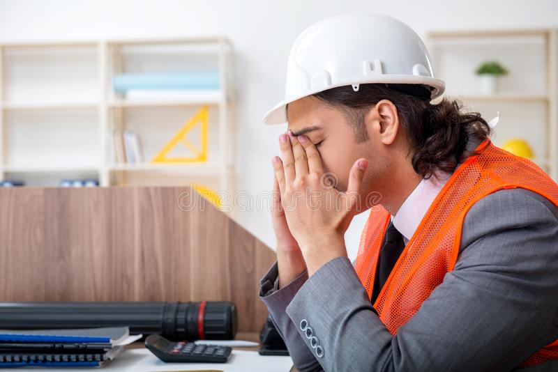 Young male architect working in the office royalty free stock photos