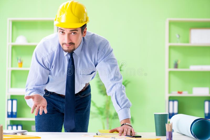 The young male architect working at the project. Young male architect working at the project stock image