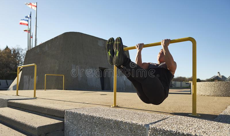 Young male athlete using hurdle to do pull ups. Montreal, Quebec, Canada stock photo
