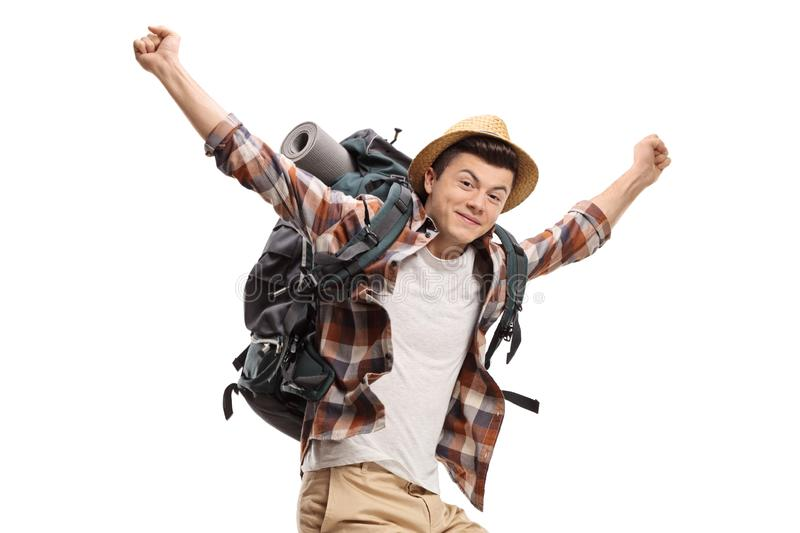 Young male backpacker jumping and gesturing happiness royalty free stock image
