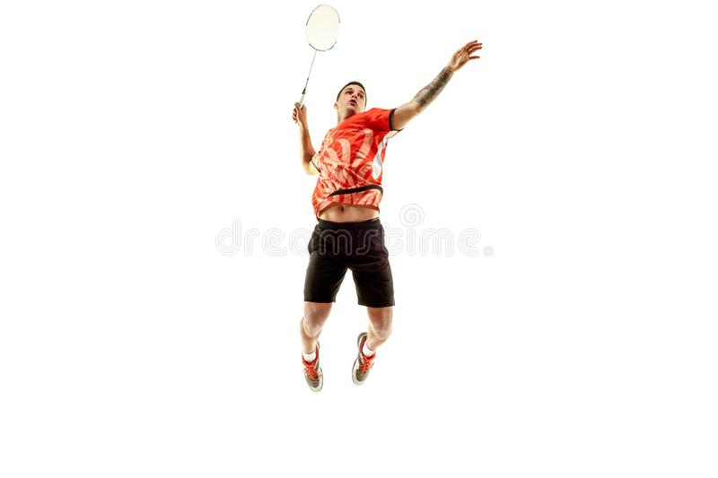 Young male badminton player over white background. Young man playing badminton over white studio background. Fit male athlete isolated on white. badminton player stock photos