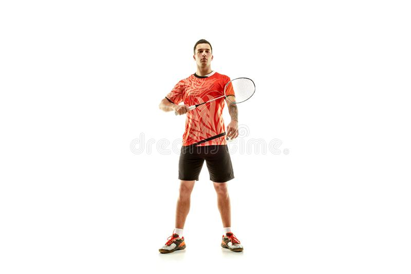 Young male badminton player over white background. Young man badminton player standing over white studio background. Fit male athlete stock images