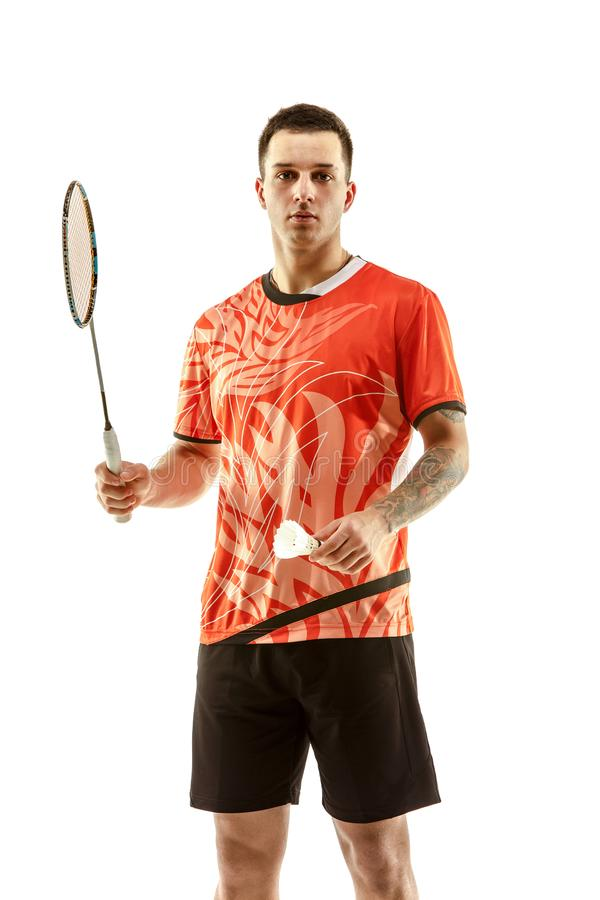 Young male badminton player over white background. Young man badminton player standing over white studio background. Fit male athlete stock image