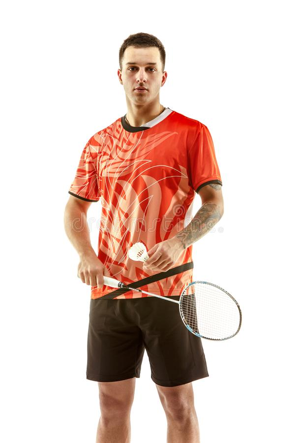 Young male badminton player over white background. Young man badminton player standing over white studio background. Fit male athlete royalty free stock photography
