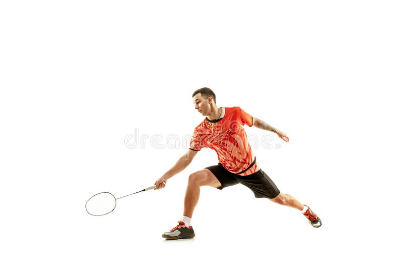 Young male badminton player over white background. Young man playing badminton over white studio background. Fit male athlete isolated on white. badminton player stock photography