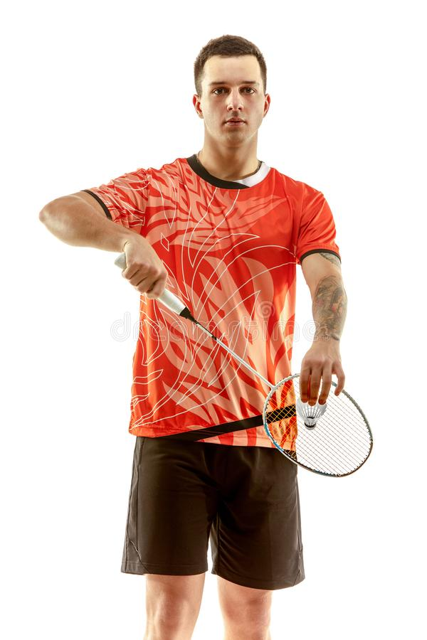 Young male badminton player over white background. Young man playing badminton over white studio background. Fit male athlete isolated on white. badminton player stock photo