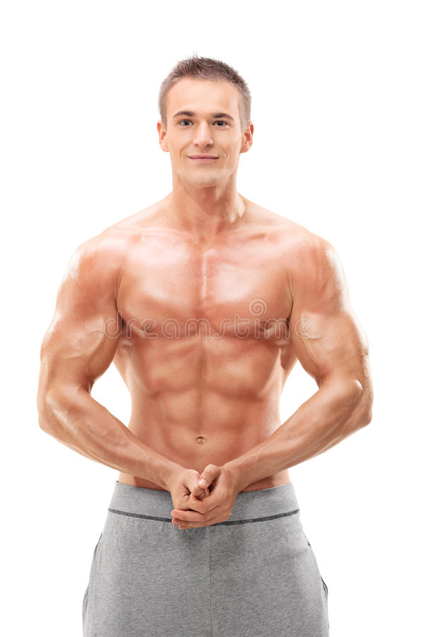 Young male bodybuilder flexing his muscles royalty free stock photography