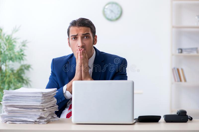 Young male businessman sitting in the office royalty free stock images