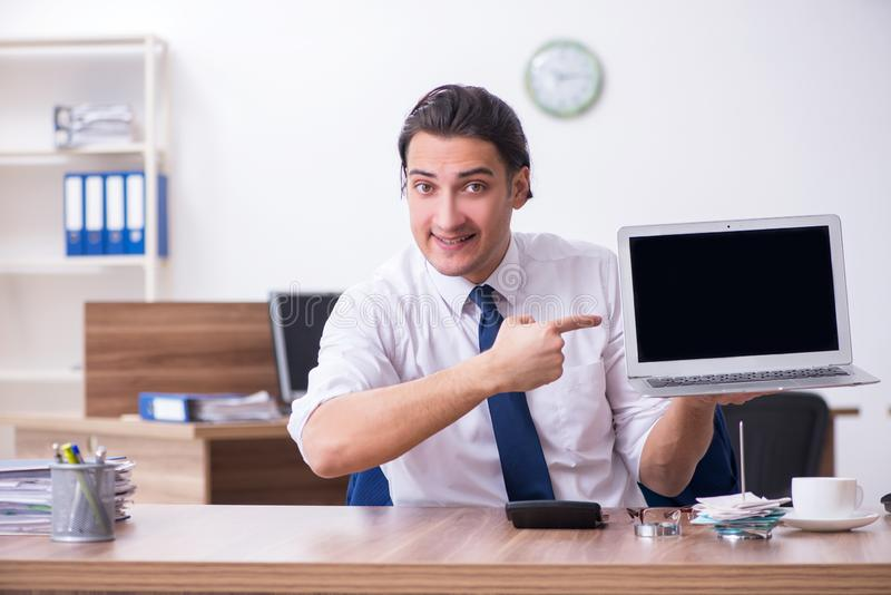 Young male businessman working in the office. The young male businessman working in the office royalty free stock photos