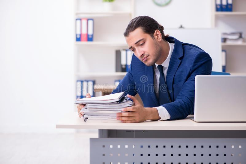 Young male businessman working in the office. The young male businessman working in the office stock photos