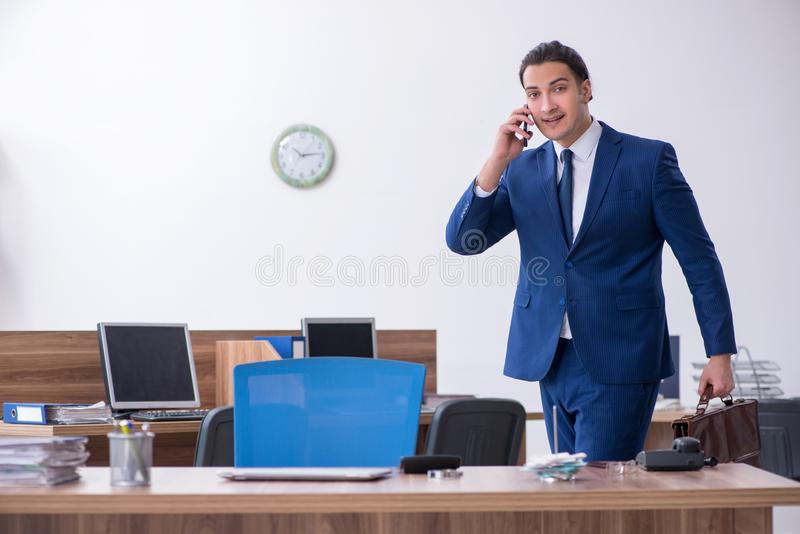Young male businessman working in the office. The young male businessman working in the office stock images